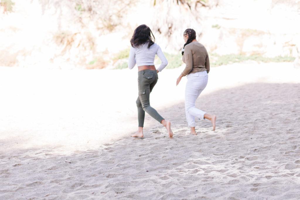 lgbt couple beach engagement running