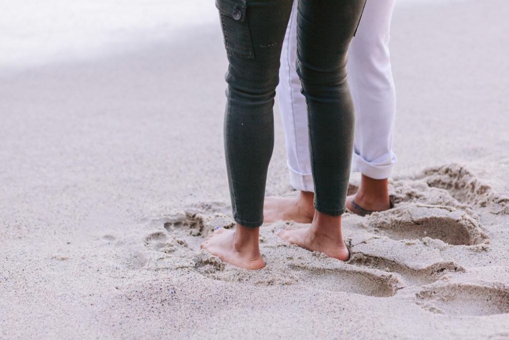lgbt couple beach engagement feet