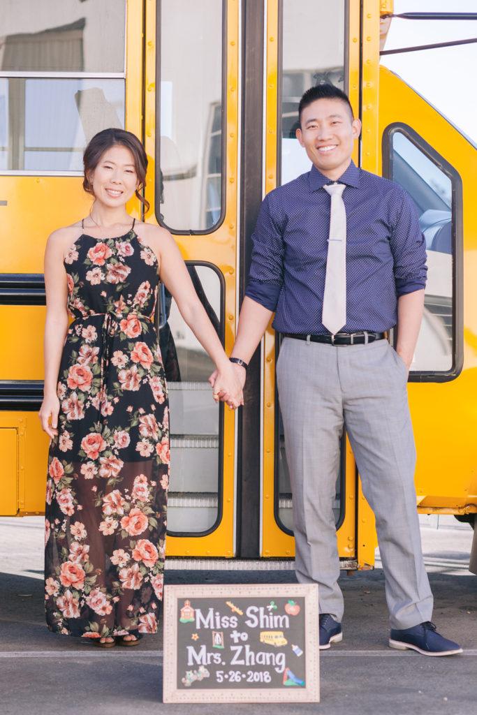 couple holding hands school bus