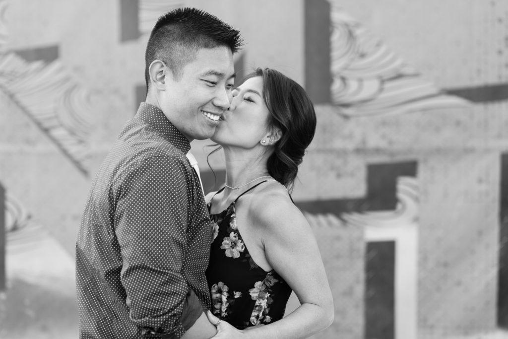 couple kissing graffiti wall