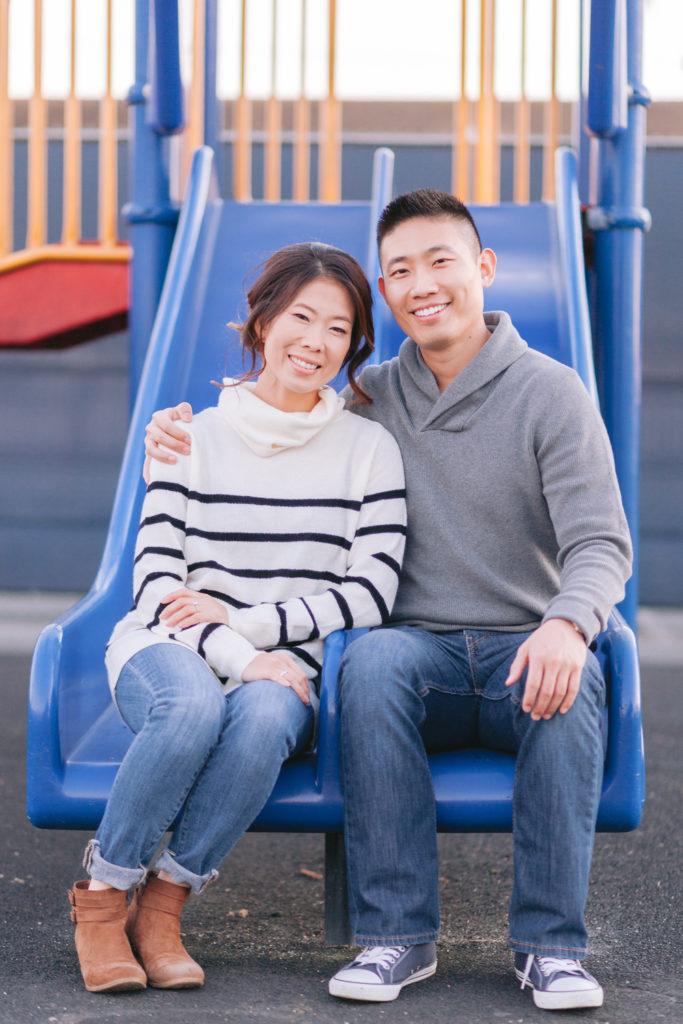 couple engagement school slide classroom playground