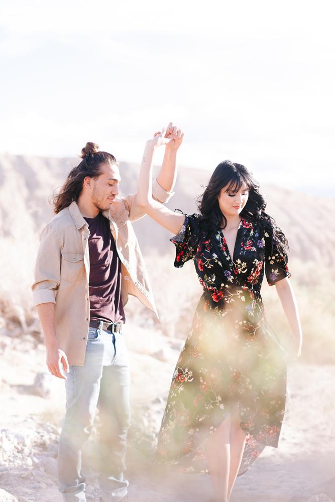 couple joshua tree high sun dancing twirl