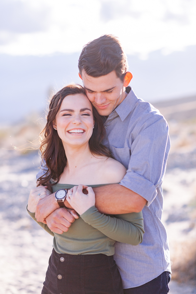 indio couple hugging engagement session
