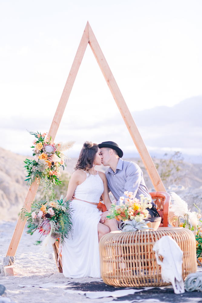 boho couple triangle arch elopement