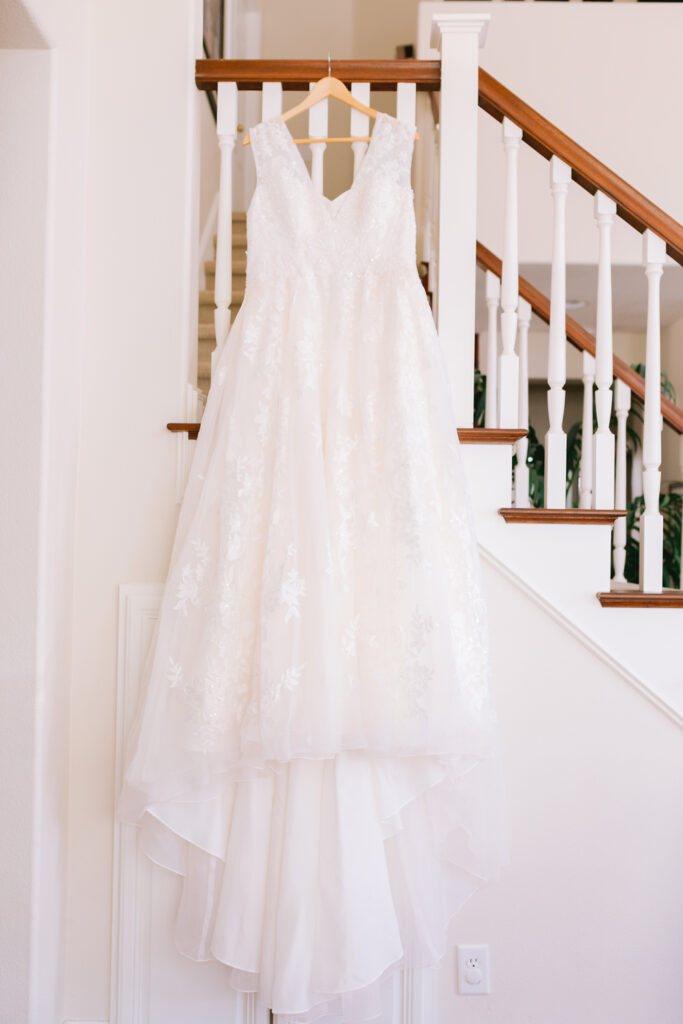 wedding dress hanging stairwell