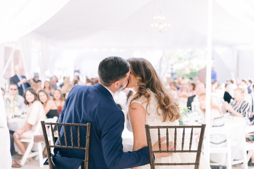 bride and groom kiss reception outdoor wedding