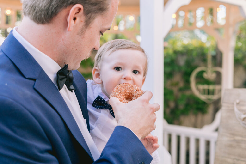 baby eating donut