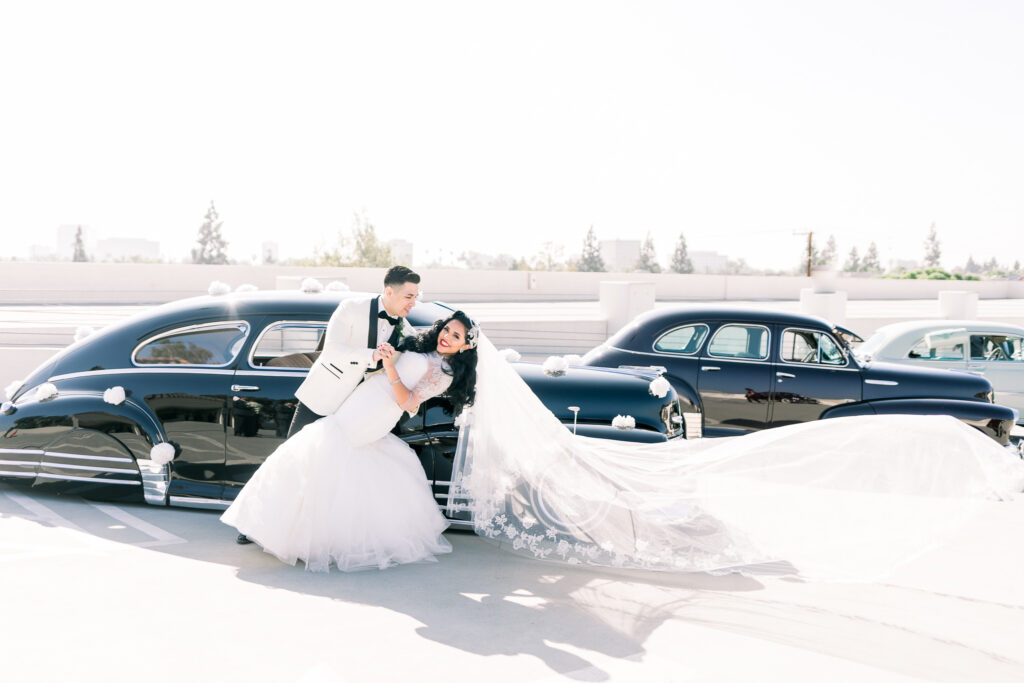 vintage wedding couple with car