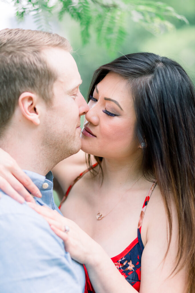 central park engagement session couple kiss